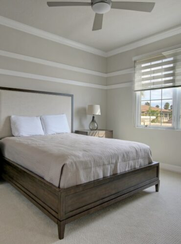 Motorized Double Roller Shades by Coullisse for a Bedroom