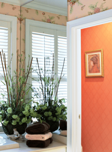 Color Coordinated to Pink Shell Wallpaper with Coral Trellis for Toilet Area by Thibaut