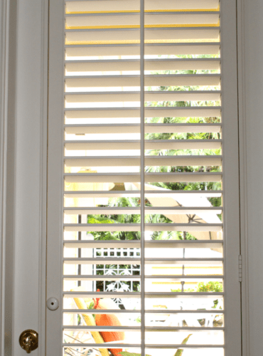 Polysatin Shutters for a Bath Door from Hunter Douglas, Wallpaper by Thibaut