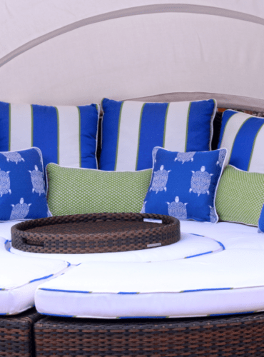 Seat Cushions with Welt of Contrasting Fabric and Colorful Pillows for Outdoor Area made with Sunbrella by Thibaut