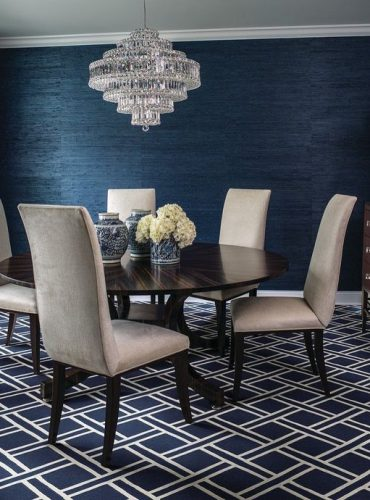 A striking marine colored geometric patterned nylon carpet in a  contemporary dining room from Stanton Carpet